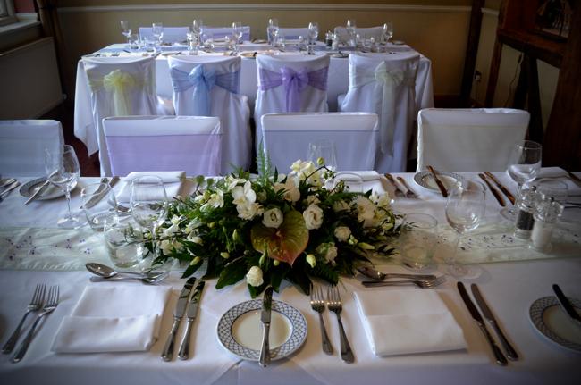 The Bell Inn New Forest wedding venue table arrangement